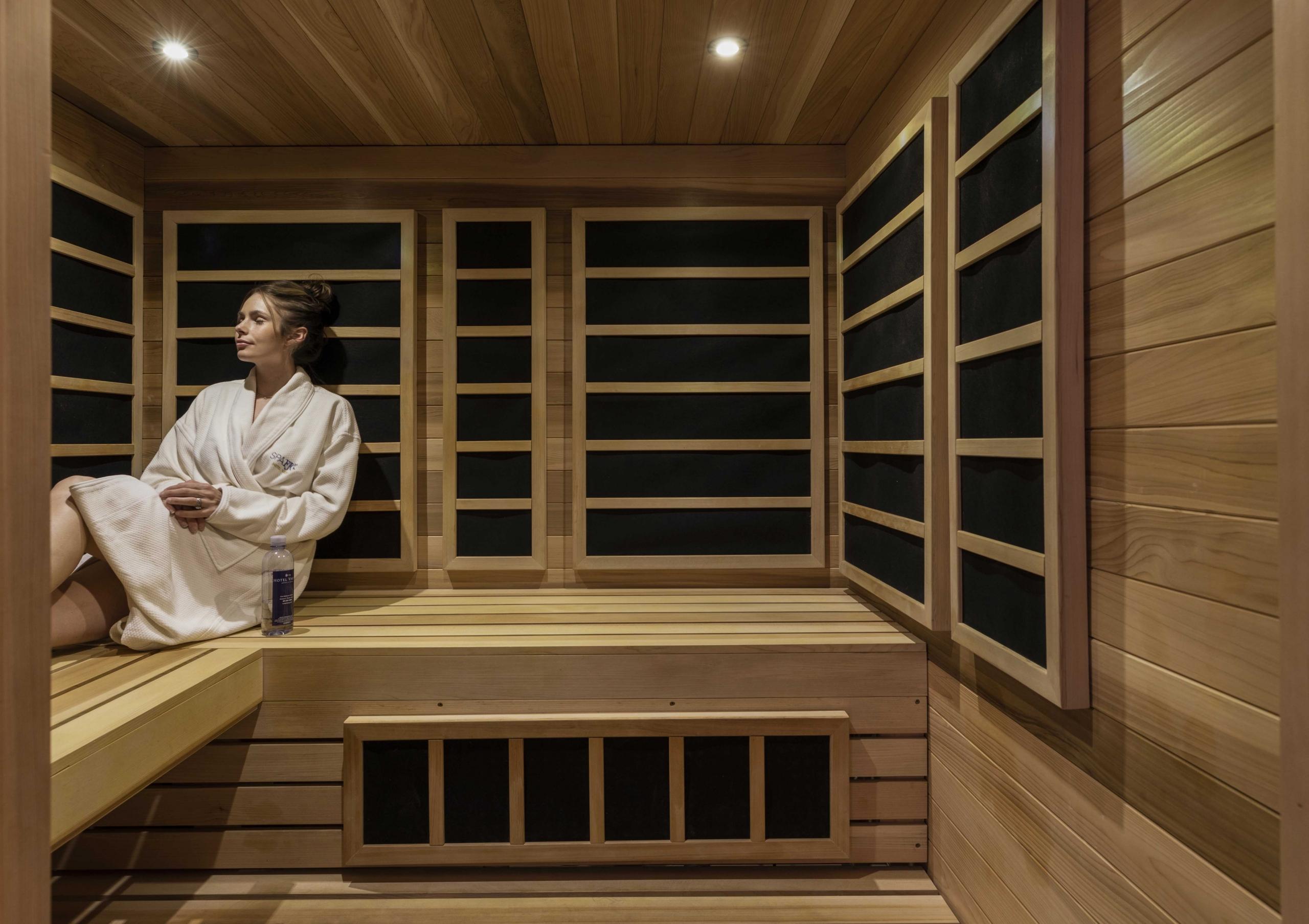 woman sitting and enjoying the sauna