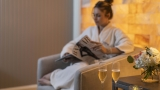 woman relaxing in the spa with glasses of champagne