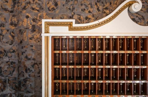 a wall of room keys at Hotel Viking