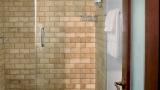 Glass shower with rain showerhead
