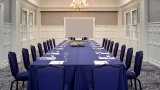 Image of a conference room with a large dining table.